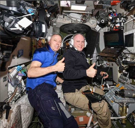 Expedition 56 Cmdr. Drew Feustel of NASA, left, and Soyuz MS-08 Cmdr. Oleg Artemyev of Roscosmos inside the Zvezda service module, practicing the Soyuz descent procedures they would use when they returned to Earth.