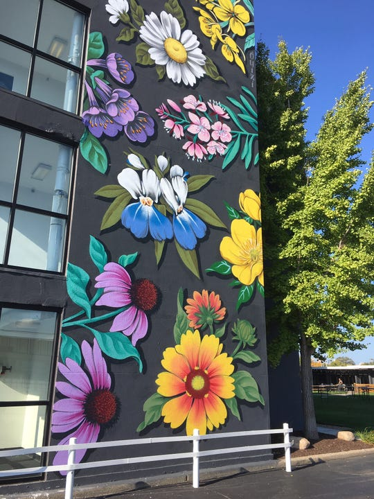 A recently completed mural by Detroit artist Ouizi at Trumbull & Porter hotel.