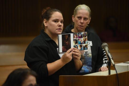 Stephanie Barrett , left, aunt of Gabby Barrett, displays photographs of her niece Gabby Barrett during the sentencing of Brad Edward Fields  for the 4-year-old's death.