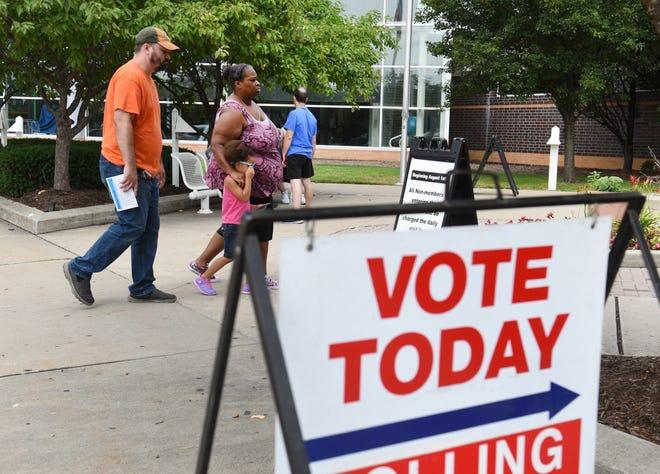 People enter the voting precinct on Tuesday, August 7, 2018 outside Warren Community Center in Warren.