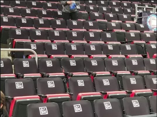 Black seats will become a permanent fixture at Little Caesars Arena.