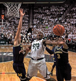 Michigan State's Cassius Winston (5) and Michigan's Zavier Simpson (3) are two of the Big Ten's top returning guards this season.