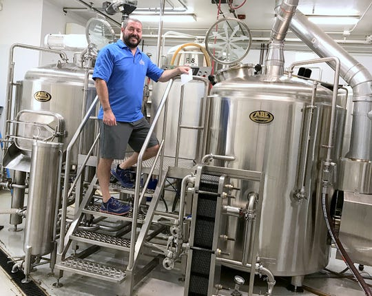 Mark Neumann, owner of Upstate Brewing Co. in Horseheads, shows off the new brew house that will enable him to increase output of craft beer by more than a third.