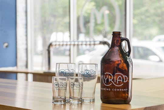 Myriad Brewing Company glassware and growler.