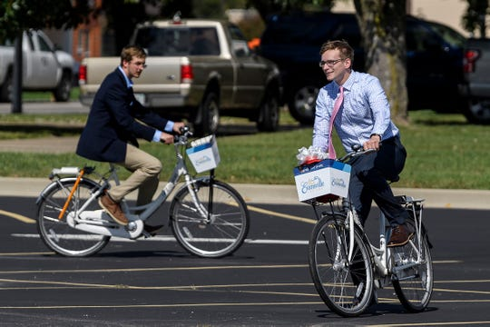 Noah Schulz, front right, Ivy Tech's Student Government Association President, and Andrew Meyer, back left, SGA Vice President, test out bicycles at the new Evansville Trails Coalition Upgrade bike share location located at the corner of Colonial Avenue and First Avenue beside the Ivy Tech campus in Evansville, Tuesday afternoon.