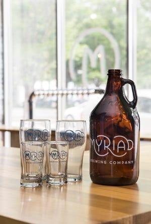 Myriad Brewing Company glassware and growler.
