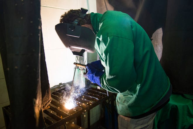 Avery Evans practices some basic welding techniques during class in the Poudre High School metal shop on Tuesday, October 9, 2018.