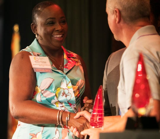 Karen Watson of Our Mother's Home accepts her award for 2018 Nonprofit Executive of the Year at the Excellence in Nonprofit Performance Yearly Awards on Tuesday, Oct. 9, 2018.