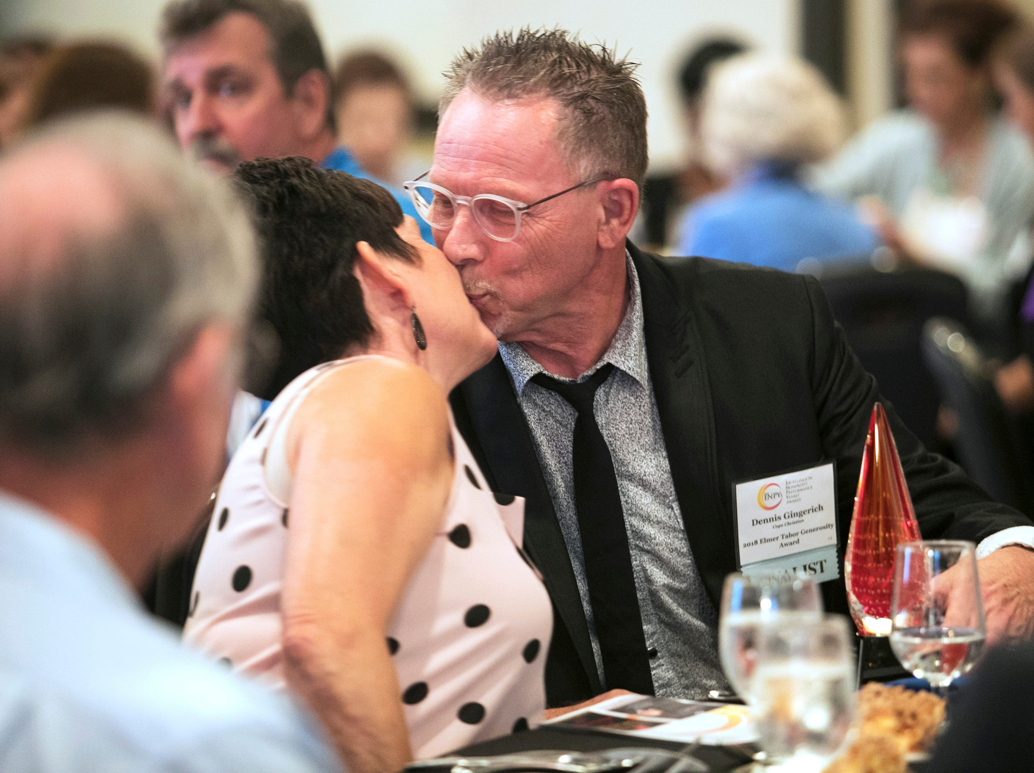 Dennis Gingerich gets a congratulatory kiss from his wife Linda after he won the 2018 Elmer Tabor Generosity Award at the Excellence in Nonprofit Performance Yearly Awards on Tuesday, October 9, 2018, in Fort Myers.