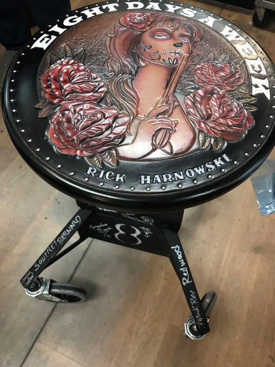 Rick Harnowski's custom-made stool in his Tattoos by Rick studio was a surprise gift in 2017 at the international tattoo convention he hosted in Green Bay.