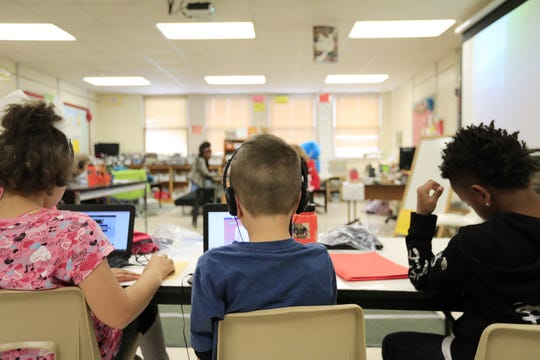 Third graders work during class at Howe Elementary Community School on Friday in Green Bay.