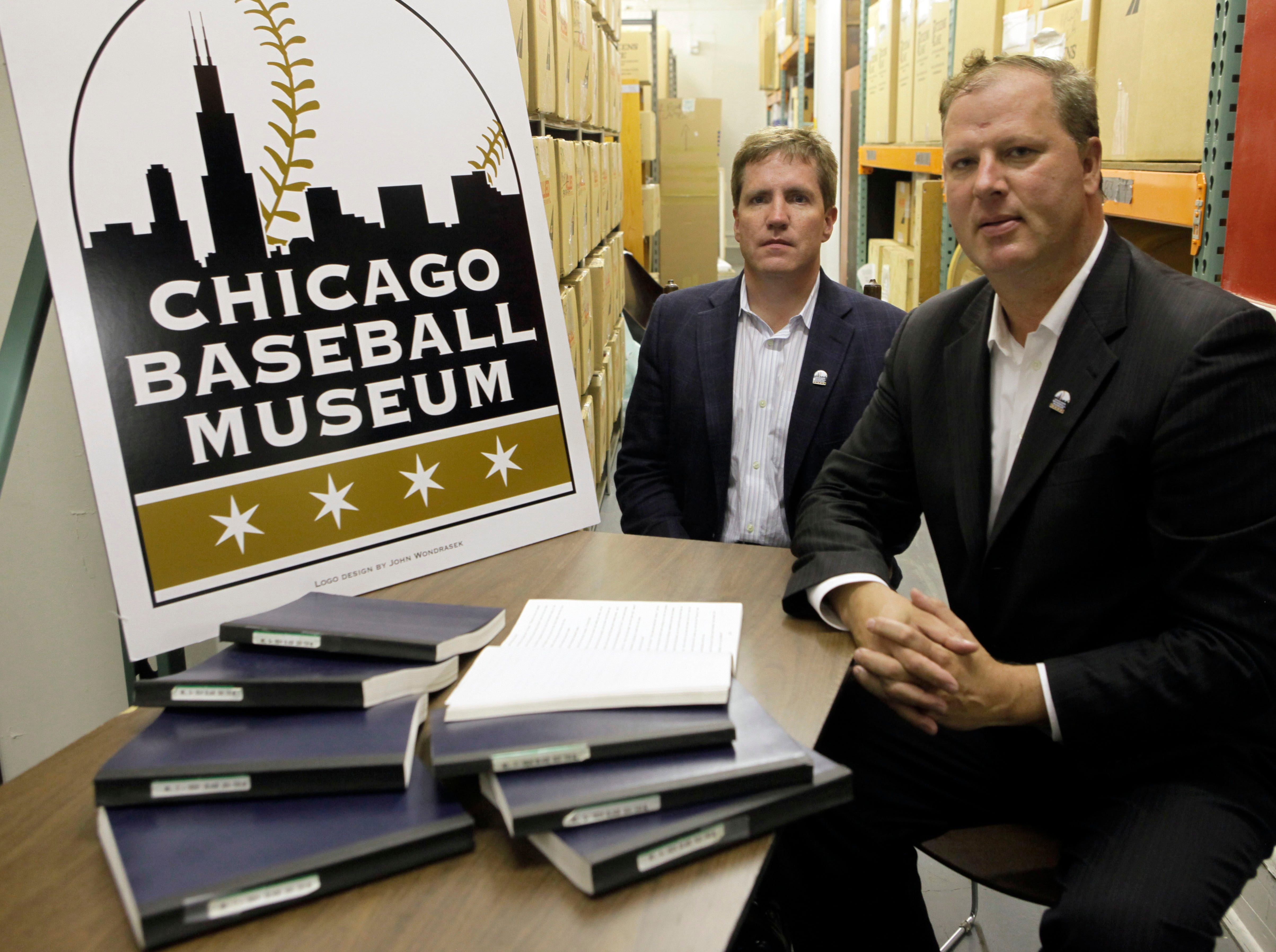 "** ADVANCE FOR WEEKEND EDITIONS, SEPT. 12-13 **  In this photo taken Thursday, Sept. 10, 2009, attorneys Paul Duffy, left, and Dan Voelker sit next to the transcript of the Black Sox trial in Chicago. The kid pleading with Shoeless Joe Jackson to ""Say it ain't so"" is one of the most enduring stories in baseball history. Now two Chicago attorneys have concluded it ain't so after all. They combed through documents and an author's notes to conclude Jackson was not a cheater who helped the White Sox throw the 1919 World Series. And they also found no evidence the kid ever existed. (AP Photo/Kiichiro Sato)"