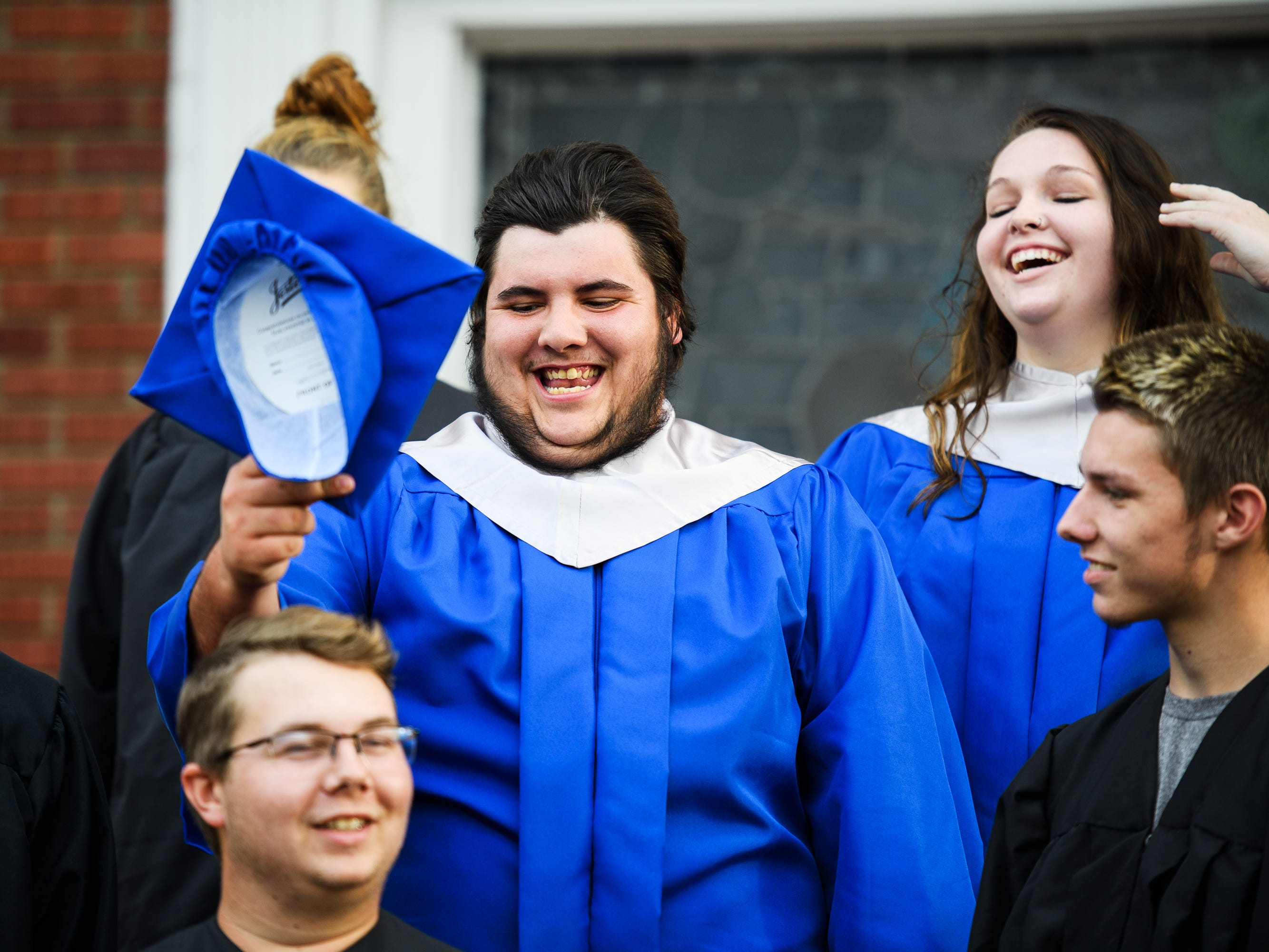 Byrnes High School student Joshua Lee Vanghn laughs with his friends before an early graduation ceremony at Pleasant Grove Baptist Church on Tuesday, Oct. 9, 2018.