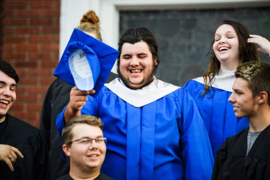 Byrnes High School student Joshua Lee Vaughn laughs with his friends before an early graduation ceremony at Pleasant Grove Baptist Church on Tuesday, Oct. 9, 2018.