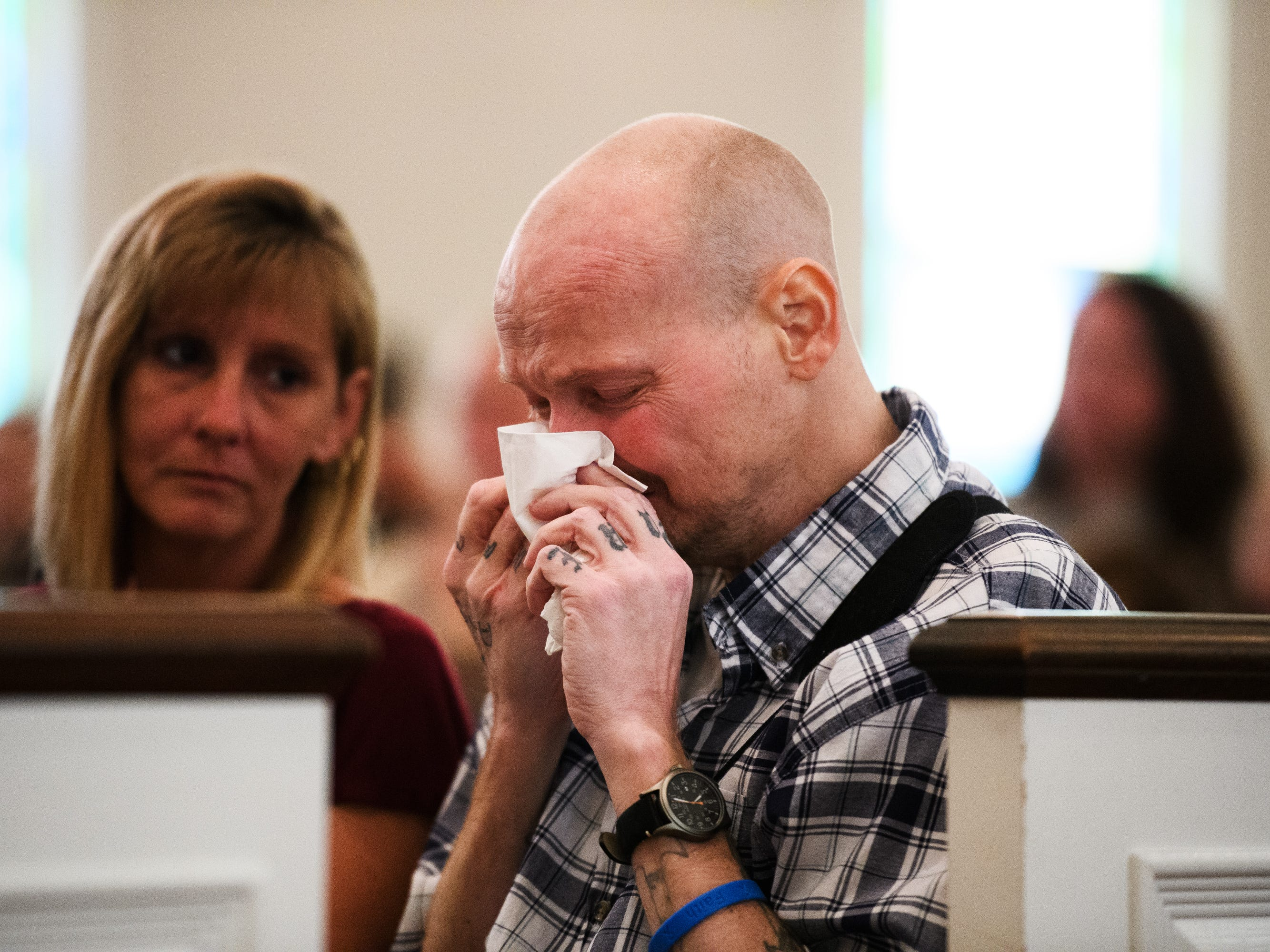 Nicholas Hughes cries as he watches an early graduation ceremony for his son Joshua Lee Vanghn at Pleasant Grove Baptist Church on Tuesday, Oct. 9, 2018.