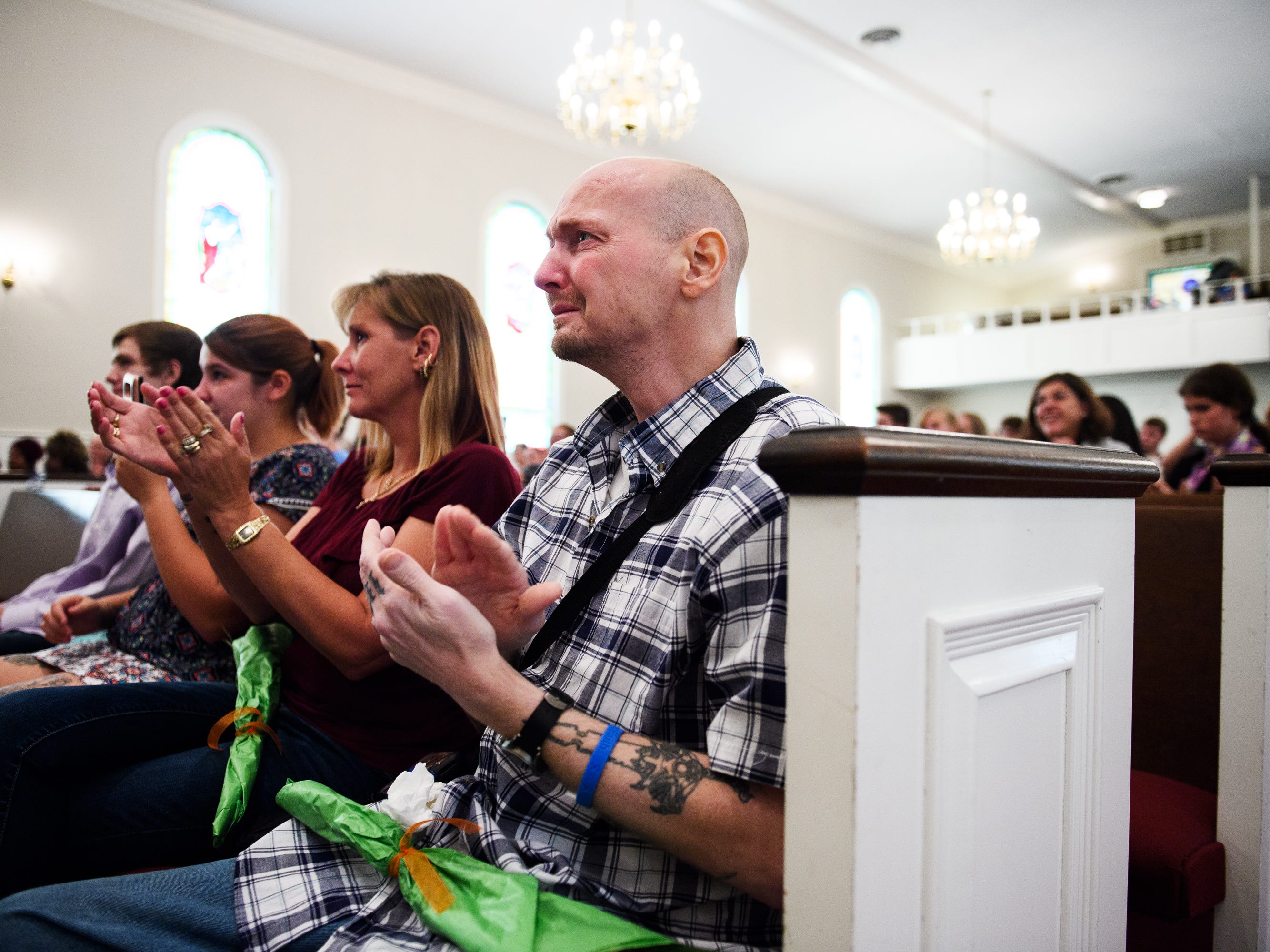 Nicholas Hughes cries as he applauds during a surprise graduation ceremony for his son Joshua Lee Vanghn at Pleasant Grove Baptist Church on Tuesday, Oct. 9, 2018.