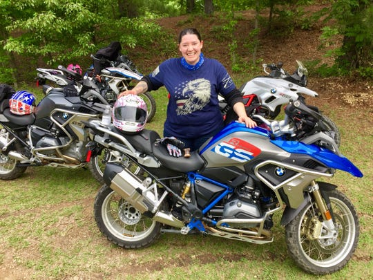 Stephanie Cutts and her motorcycle before her trip to Africa.