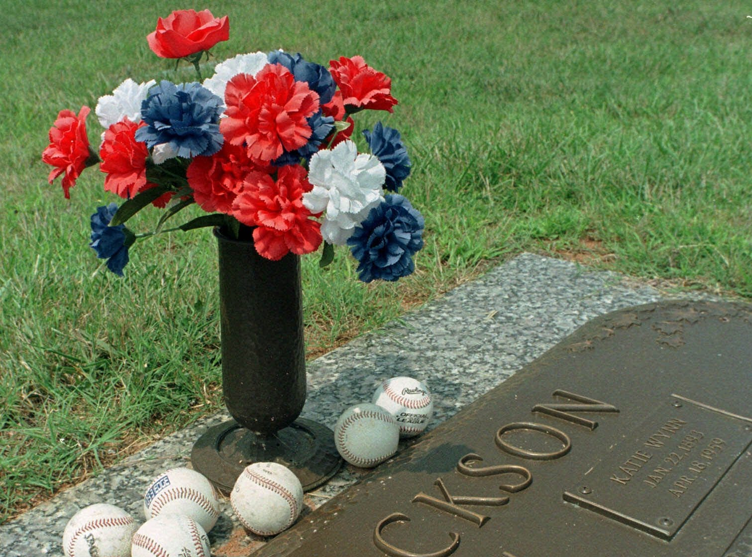 "The grave of Joseph ""Shoeless Joe"" Jackson and his wife Katie is surrounded by baseballs left by visitors at Woodlawn Memorial Gardens in Greenville, S.C., in this July 20, 1999 photo. Greenville, Jackson's hometown, is finally starting to rise and join the calls to recognize him as one of baseball's most celebrated and disgraced players deserving a place in the baseball Hall of Fame. (AP Photo/Mary Ann Chastain)"