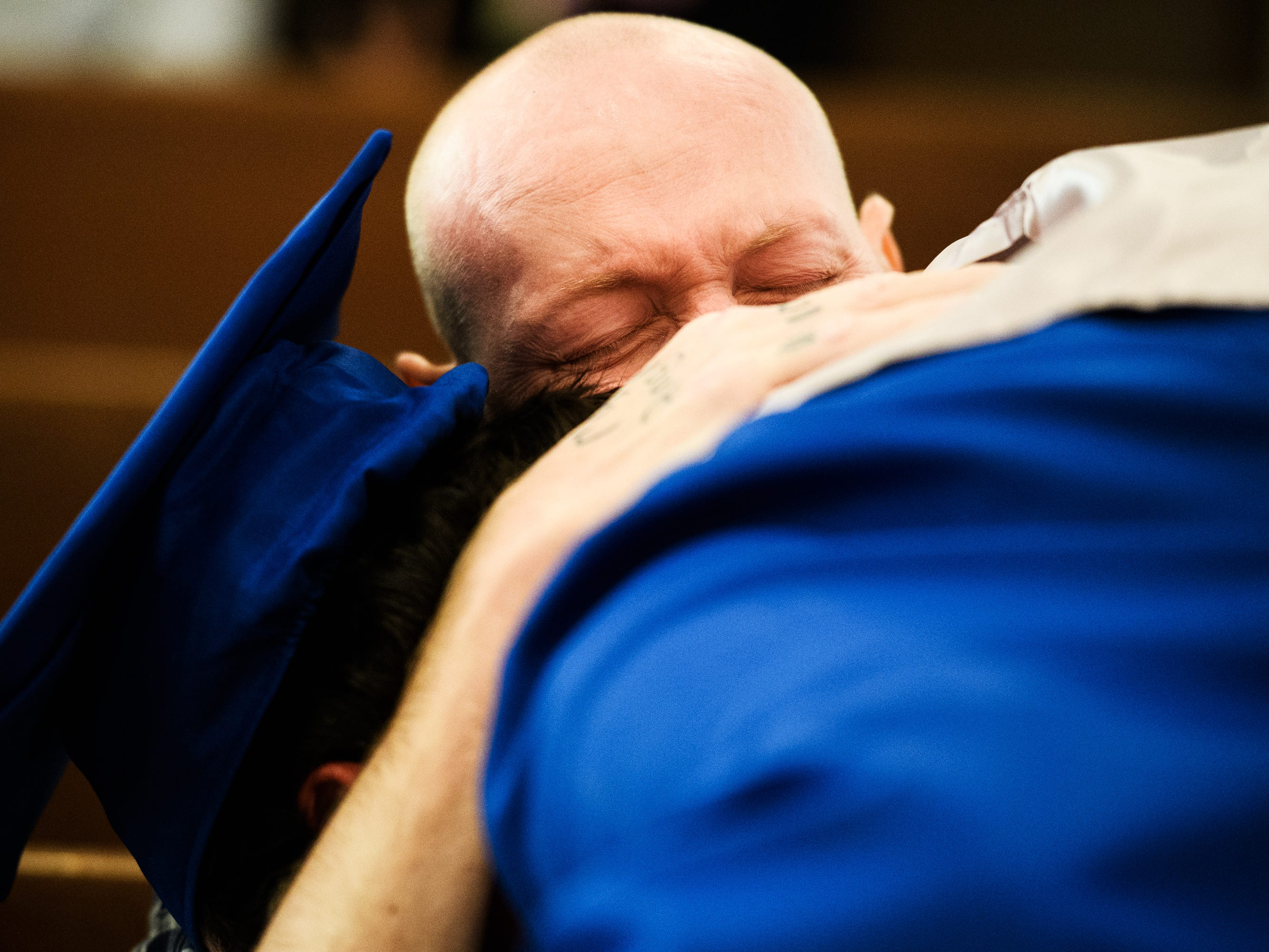 Nicholas Hughes hugs his son, Joshua Lee Vanghn, during an early commencement ceremony at Pleasant Grove Baptist Church on Tuesday, Oct. 9, 2018. The ceremony was put together to surprise Hughes, who is currently in hospice and wanted to see his son graduate.