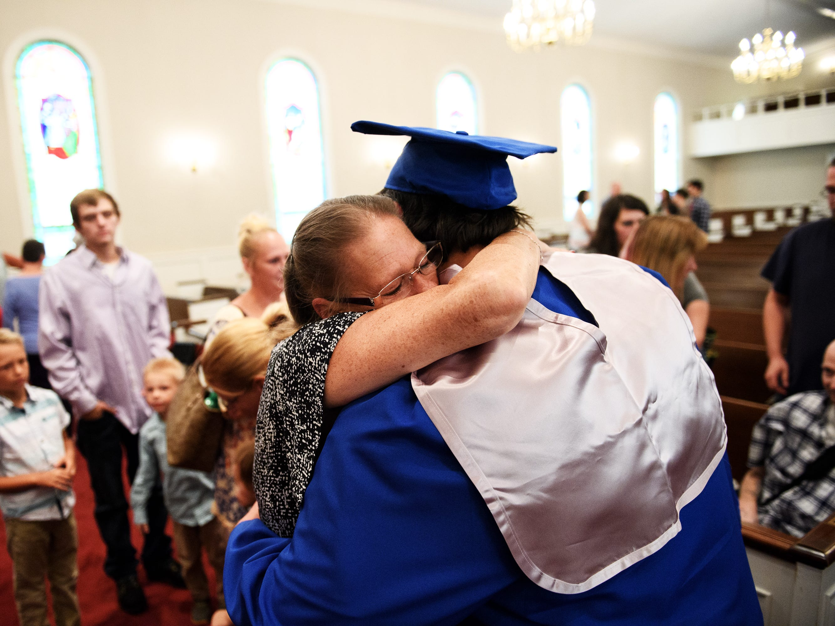 Joshua Lee Vanghn hugs his great aunt Jo White after an early graduation ceremony at Pleasant Grove Baptist Church on Tuesday, Oct. 9, 2018.