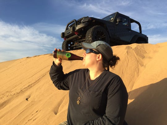 Stephanie Cutts has some refreshment in the desert of Namibia.