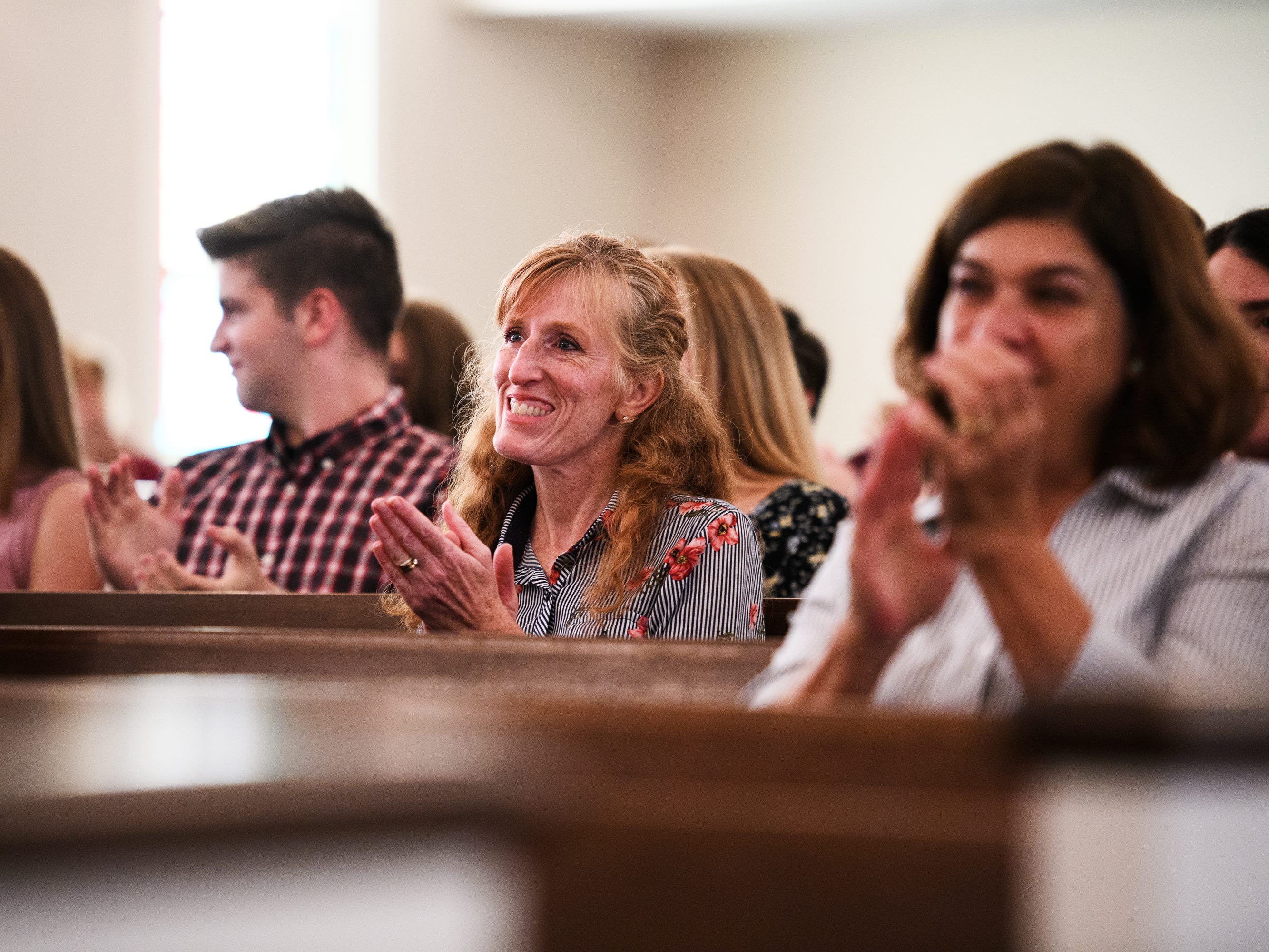 People cheer during an early graduation ceremony for Joshua Lee Vanghn at Pleasant Grove Baptist Church on Tuesday, Oct. 9, 2018.