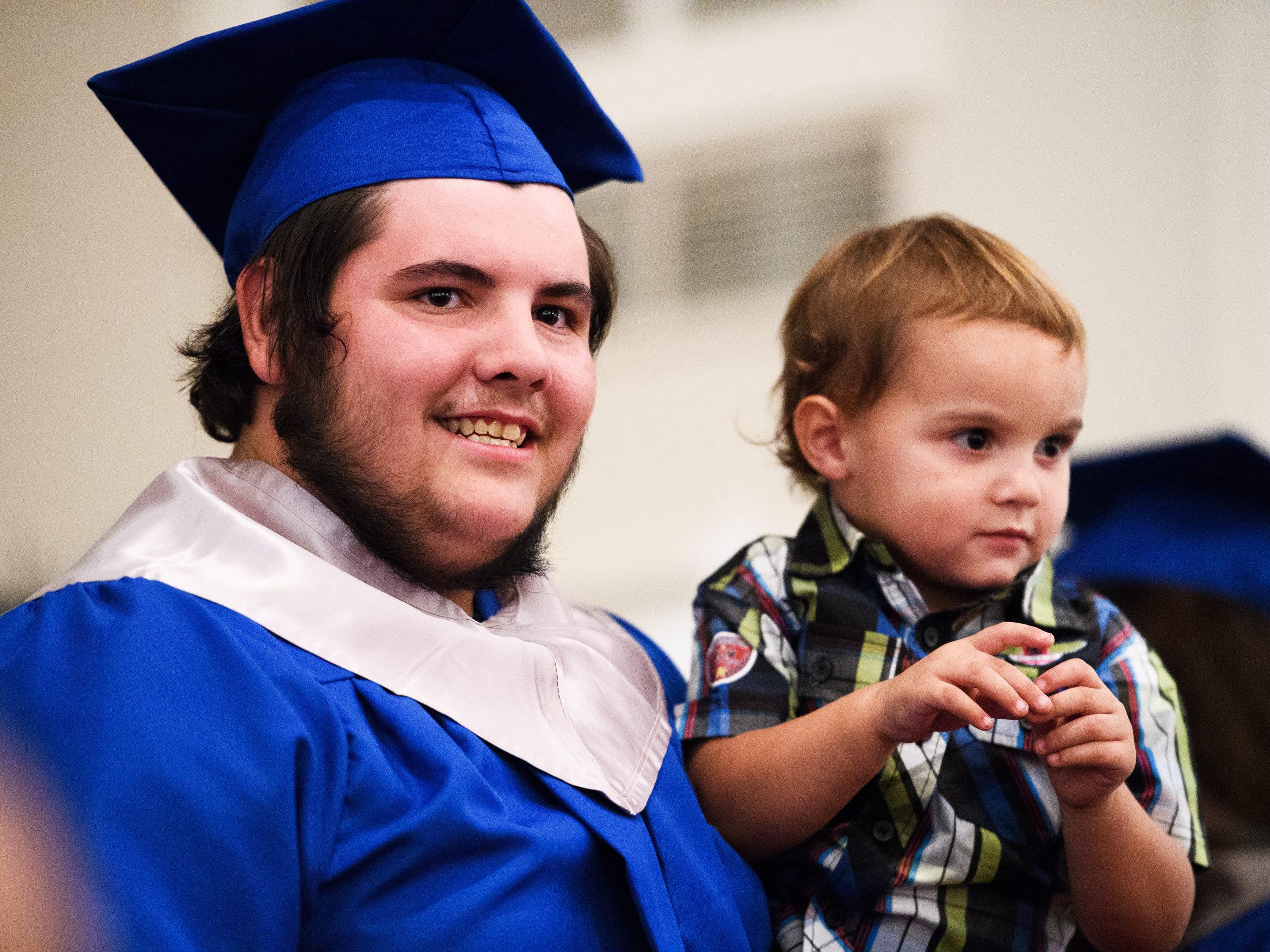 Joshua Lee Vanghn holds his nephew Jace Horne, 2, at Pleasant Grove Baptist Church on Tuesday, Oct. 9, 2018.