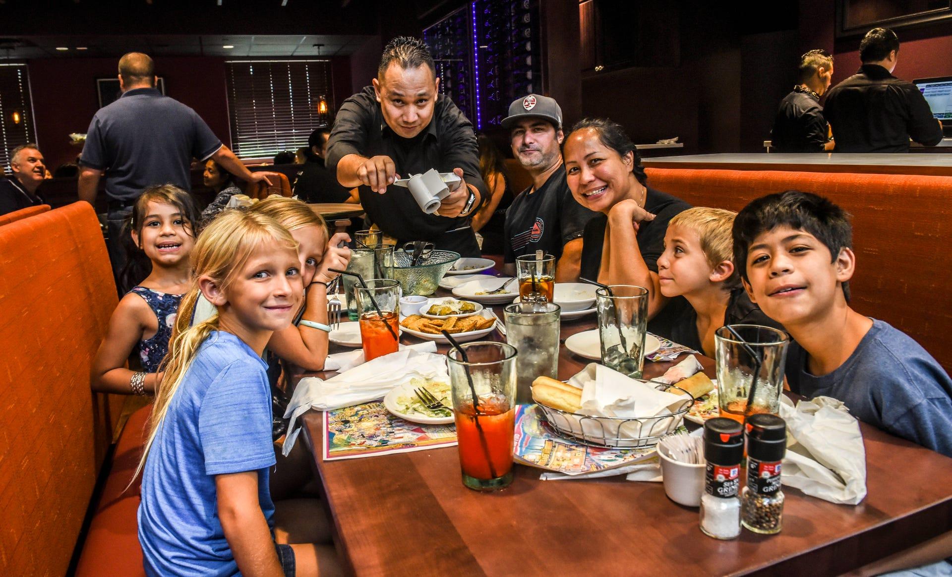 Serving Italian cuisine, Olive Garden opens its door