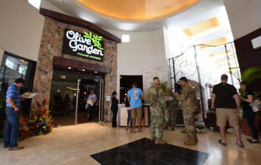 The Italian restaurant chain, The Olive Garden, opens its door to serve the public of its first day of business in Tumon on Tuesday, Oct. 9, 2018. The restaurant is the latest addition to the Tumon Sands Plaza. Signage at the plaza also indicate the future addition of a Chili's and Red Lobster restaurant.