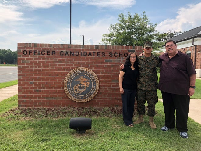Johnny S.P. Rivera of Agat graduated from the United States Marine Corps Officer Candidates School in Quantico, Virginia on Aug. 11, also marked his 24th birthday. He was promoted to the rank of second lieutenant. Johnny has an aviation contract and will be heading to flight school after The Basic School. He is pictured with his parents Johnny M. and Ann Ruth P. Rivera.