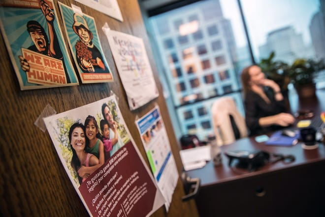 Kristin Hoffman, director of the Indiana Migrant Farmworker Law Center, works insider her office in downtown Indianapolis on Tuesday, June 26, 2018.
