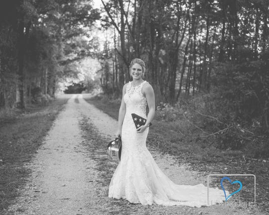 Jessica Padgett poses for a photo in her wedding dress at the Glendale Fish & Wildlife Area in Montgomery, Indiana.