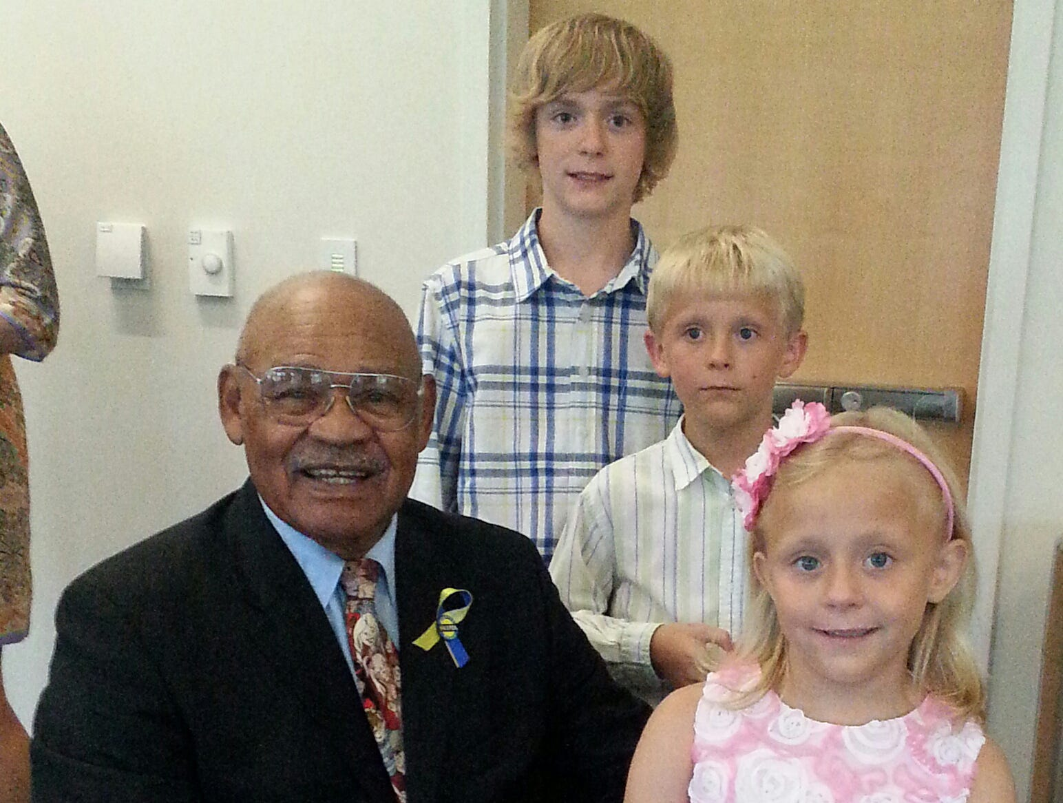 Provided by Jim and Suzanne Seid George Taliaferro sits beside Ethan Seiders, 13, and 8-year-old twins Owen and Lauren Seiders.  Taliaferro is chairman emeritus of the local Children's Organ Transplant Association. George Taliaferro with Ethan, 13, Owen, 8, and Lauren Seiders, also 8. (twins). Lauren has had multiple organ transplants. Taliaferro serves as chairman emeritus of the localChildren's Organ Transplant Association