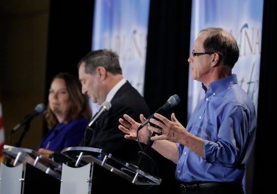 Republican Mike Braun (right) speaks during a U.S. Senate debate in Westville.