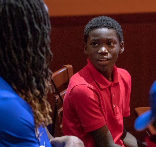 Wesley Rice, 11, smiles at a birthday party for Jack Doyle, tight end for the Indianapolis Colts, at Dave and Busters, Indianapolis, Monday, Oct. 8, 2018. About 15 kids from Dayspring Center in Indianapolis joined Doyle, his wife, and several other Colts players for the event that honored some of the kids' birthdays, and gave them a good meal and an afternoon of games at the venue.