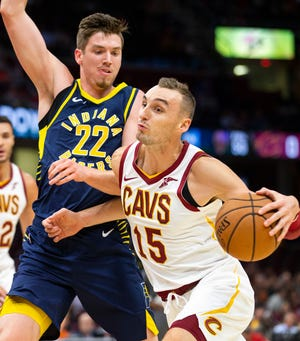 Cleveland Cavaliers forward Sam Dekker (15) dribbles around Indiana Pacers forward TJ Leaf (22) during first quarter of a preseason basketball game, Monday, Oct. 8, 2018, in Cleveland.