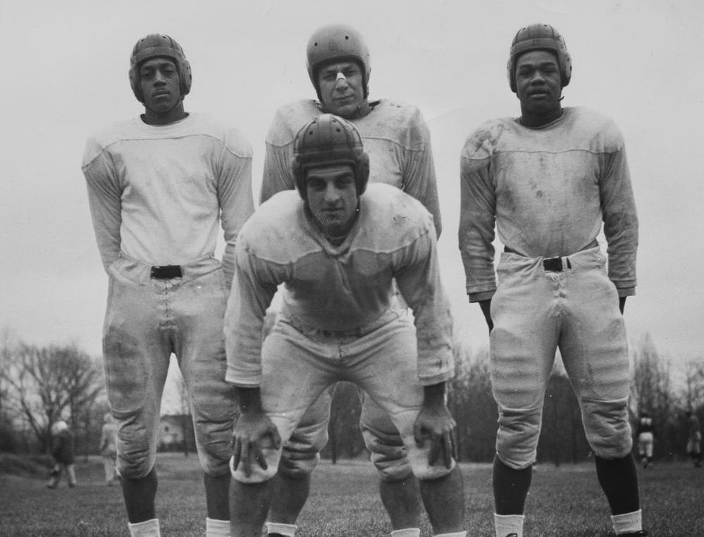 Photo provided by Indiana University archives Indian University football players Ben Raimondi (front), Melvin H. Groomes (second row, from left), Pete Pihos and George Taliaferro pose for a photo in 1945. (1st row) Ben Raimondi, (2nd row, L to R) Melvin H. Groomes, Pete Pihos, George Taliaferro Indiana University football in 1945