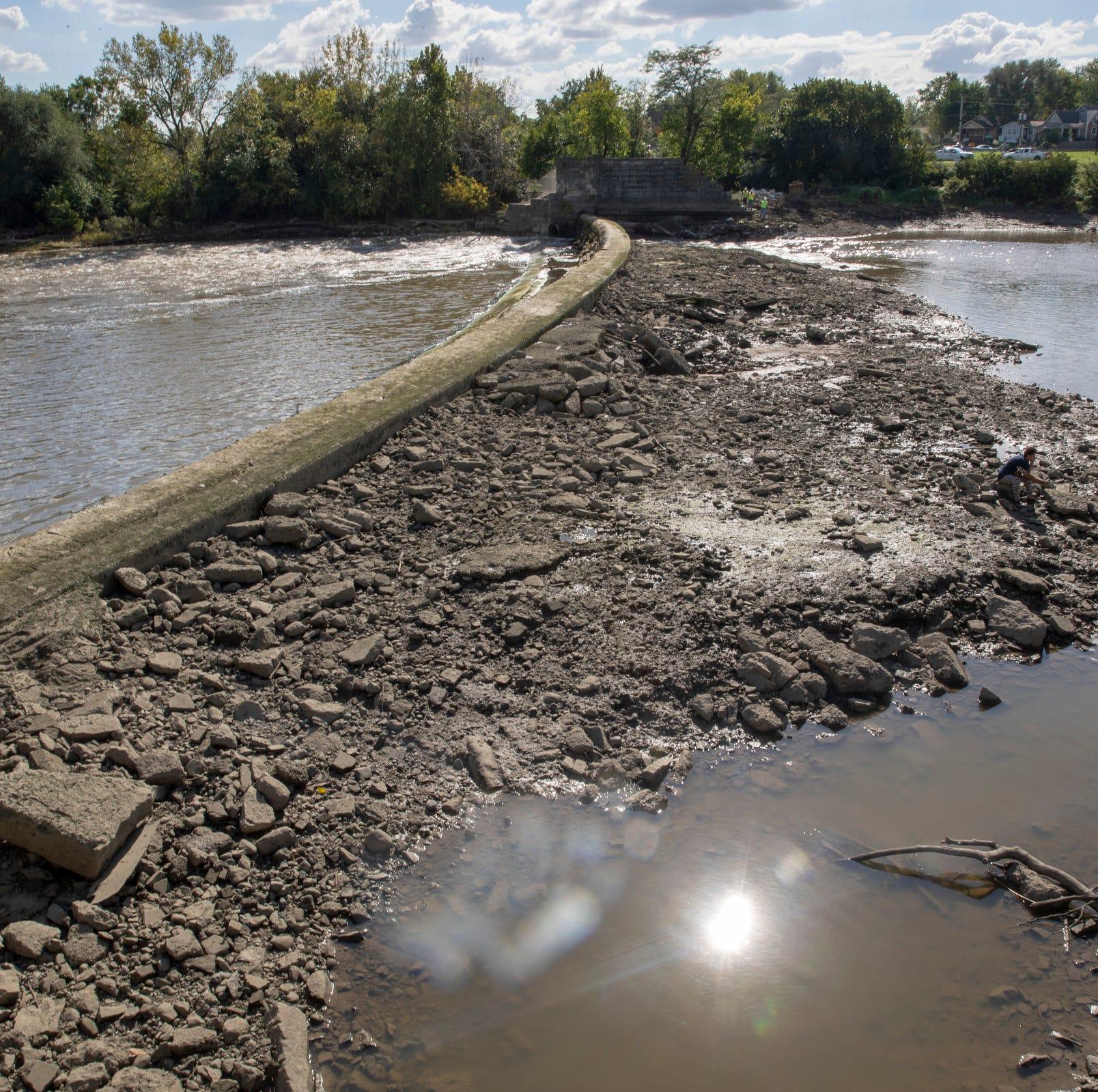 Hole in dam near 16th Street drops water levels nearly 6 feet