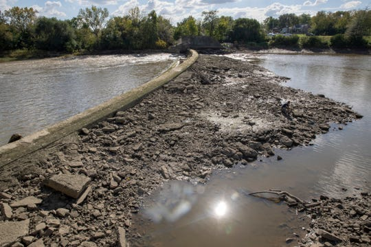 The riverbed emerges as the water levels recede on the White River.