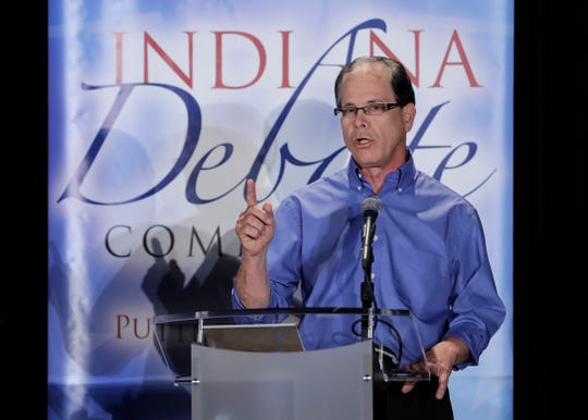 Republican Mike Braun speaks during a U.S. Senate debate against Libertarian Lucy Brenton and Democratic Sen. Joe Donnelly on Monday in Westville.