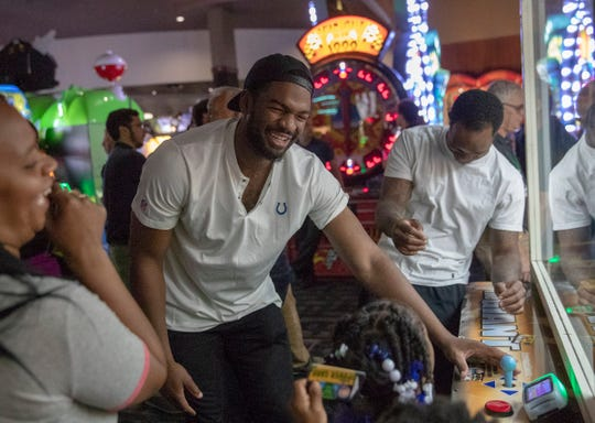 Jacoby Brissett (middle), and fellow backup quarterback Phillip Walker laugh as they play a prize grabber-style game at a birthday party for Jack Doyle, tight end for the Indianapolis Colts, at Dave and Busters, Indianapolis, Monday, Oct. 8, 2018.
