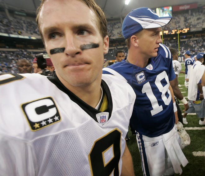 Drew Brees, quarterback for the Saints, greets Peyton Manning after the game.   The Indianapolis Colts beat New Orleans 41-10, at the RCA Dome, Indianapolis, Ind., September 06, 2007.   (Robert Scheer/The Indianapolis Star)