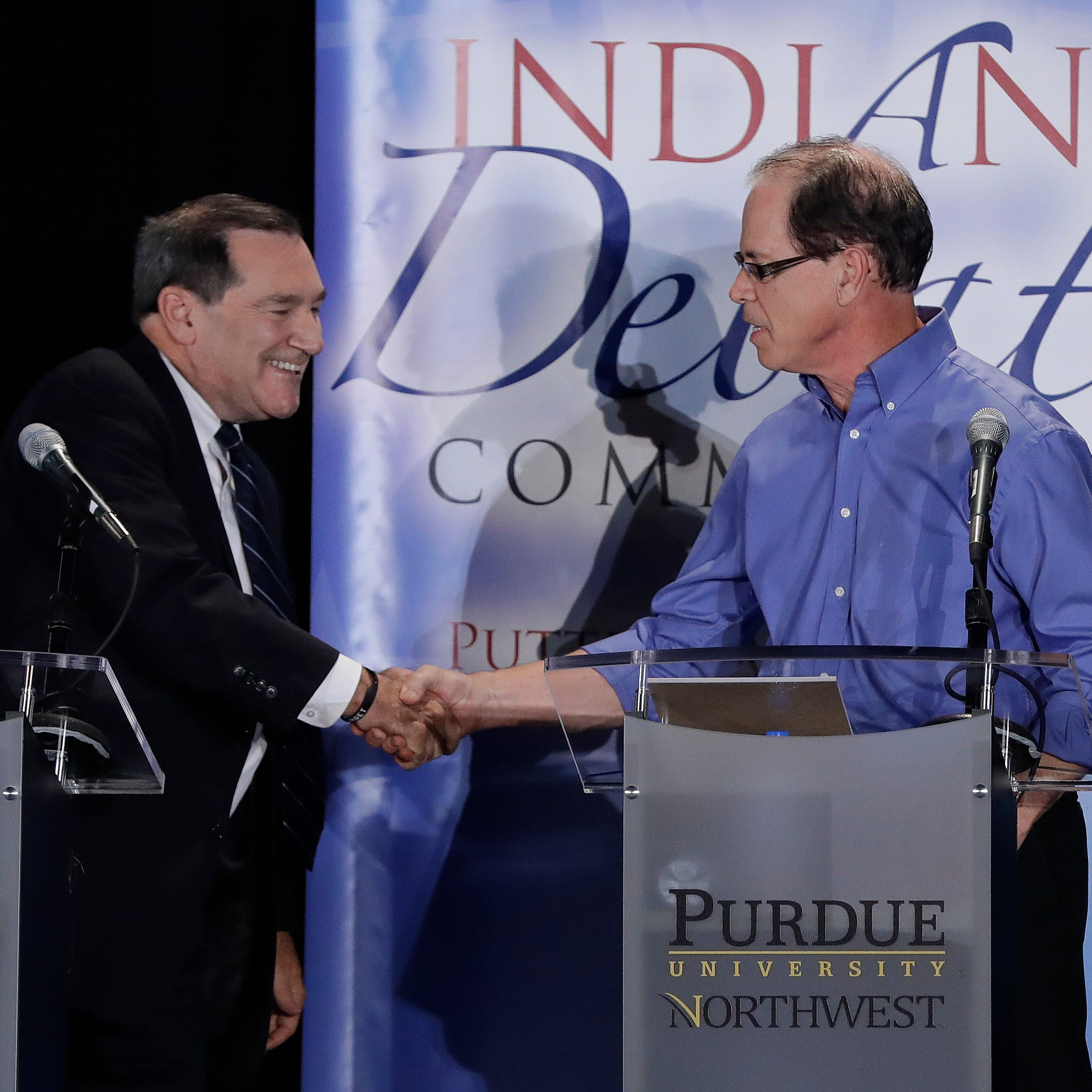 Democratic Sen. Joe Donnelly (left) wraps up a debate Monday with Republican Mike Braun in Westville.