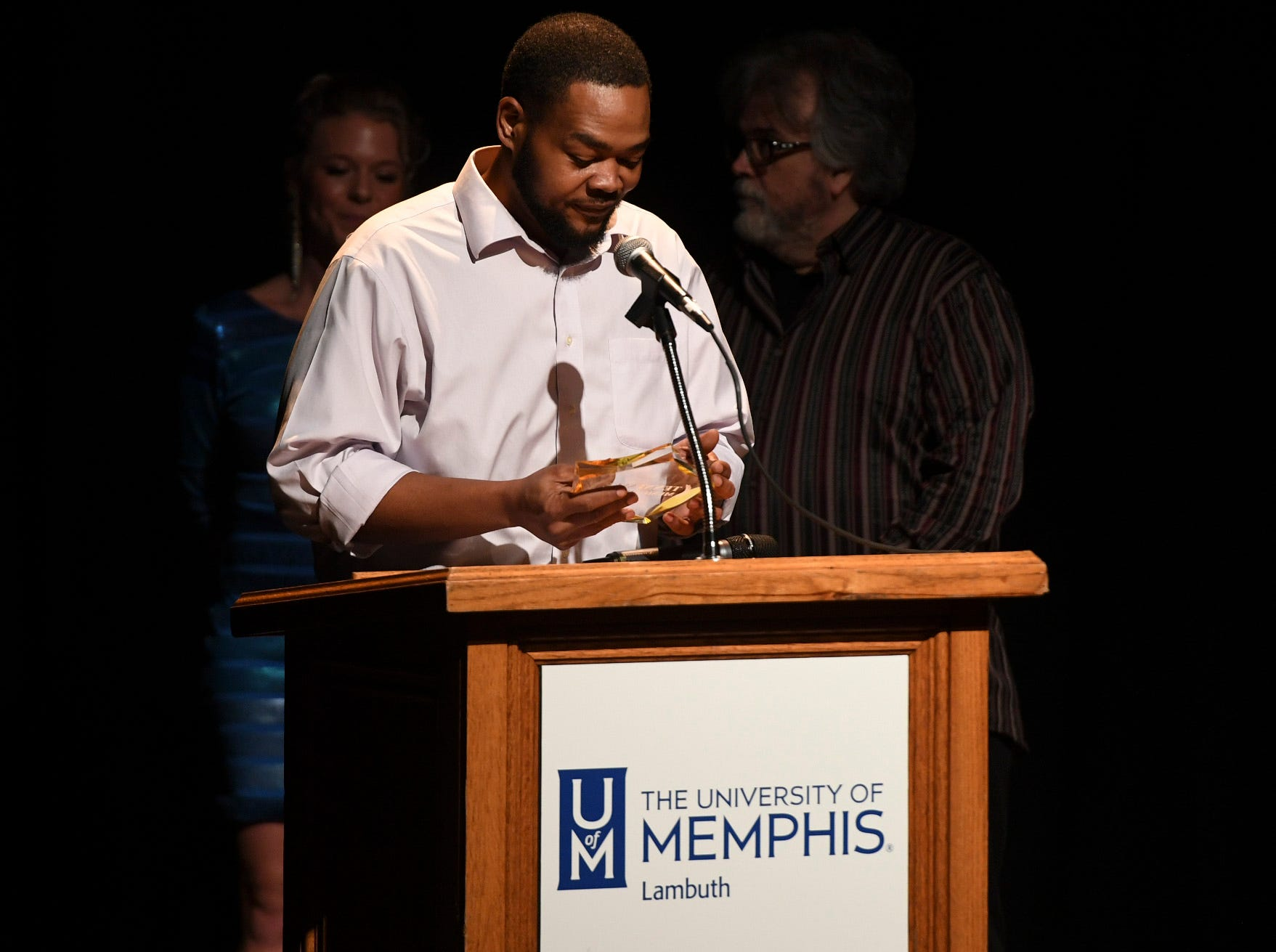 Kris Dickerson looks at his award during his acceptance speech for Drummer of the Year during the 2nd Annual Tennessee Music Awards, Monday, October 8, at University of Memphis Lambuth.
