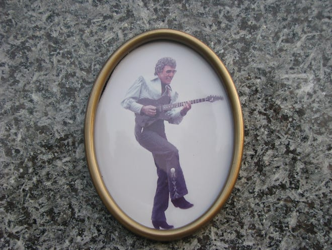 Image of Carl Perkins displayed on his crypt, and online at www.rockabillyhall.org - website for the International Rock-A-Billy Hall of Fame in Jackson.