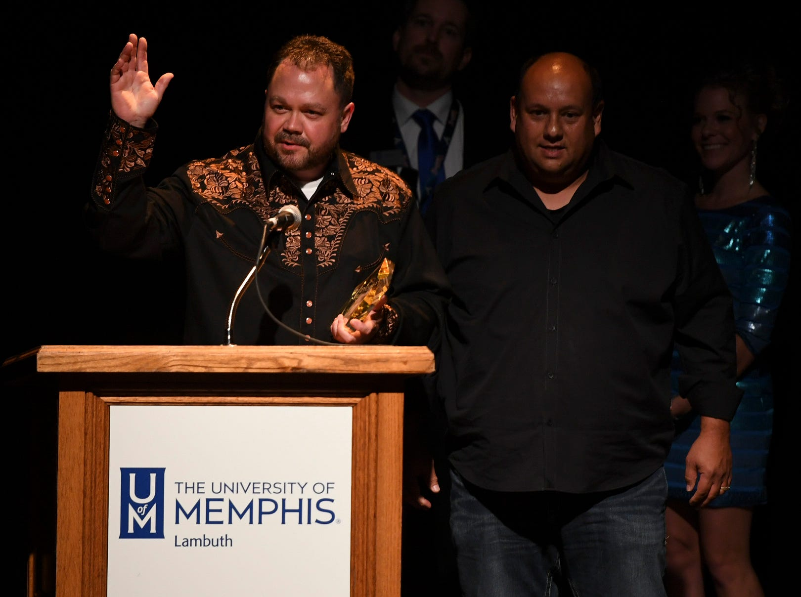 A member of the band No Time Flatt accepts the award for Bluegrass Band of the Year during the 2nd Annual Tennessee Music Awards, Monday, October 8, at University of Memphis Lambuth.