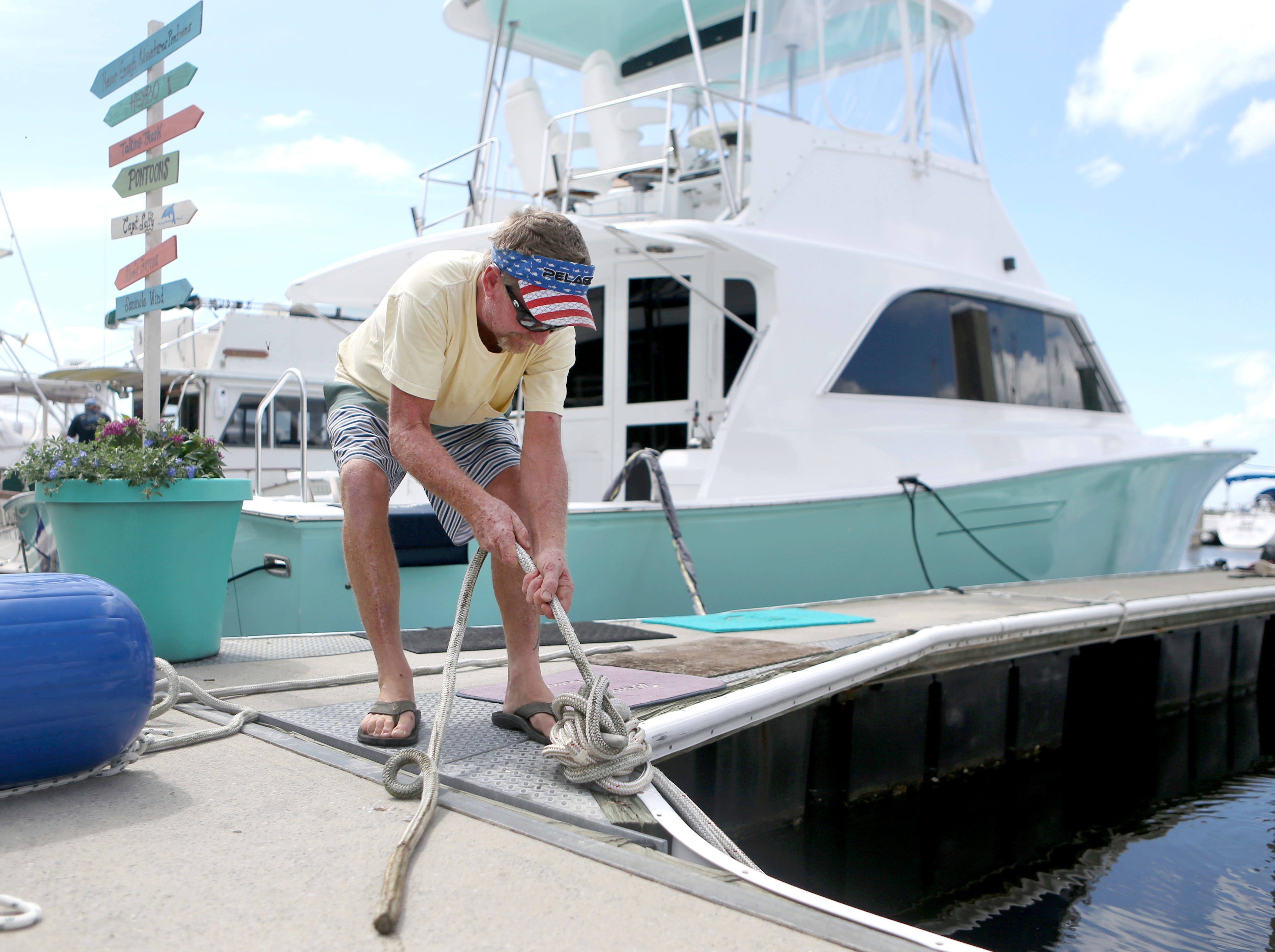 Rob Docko ties a knot while securing his boat at the St. Andrews Marina in Panama City, Fla., Monday, Oct. 8, 2018, to prepare for Hurricane Michael.