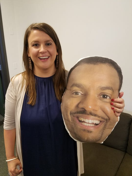 """Tonya McDonald poses with a cut out of """"America's Funniest Home Videos"""" host Alfonso Ribeiro."""