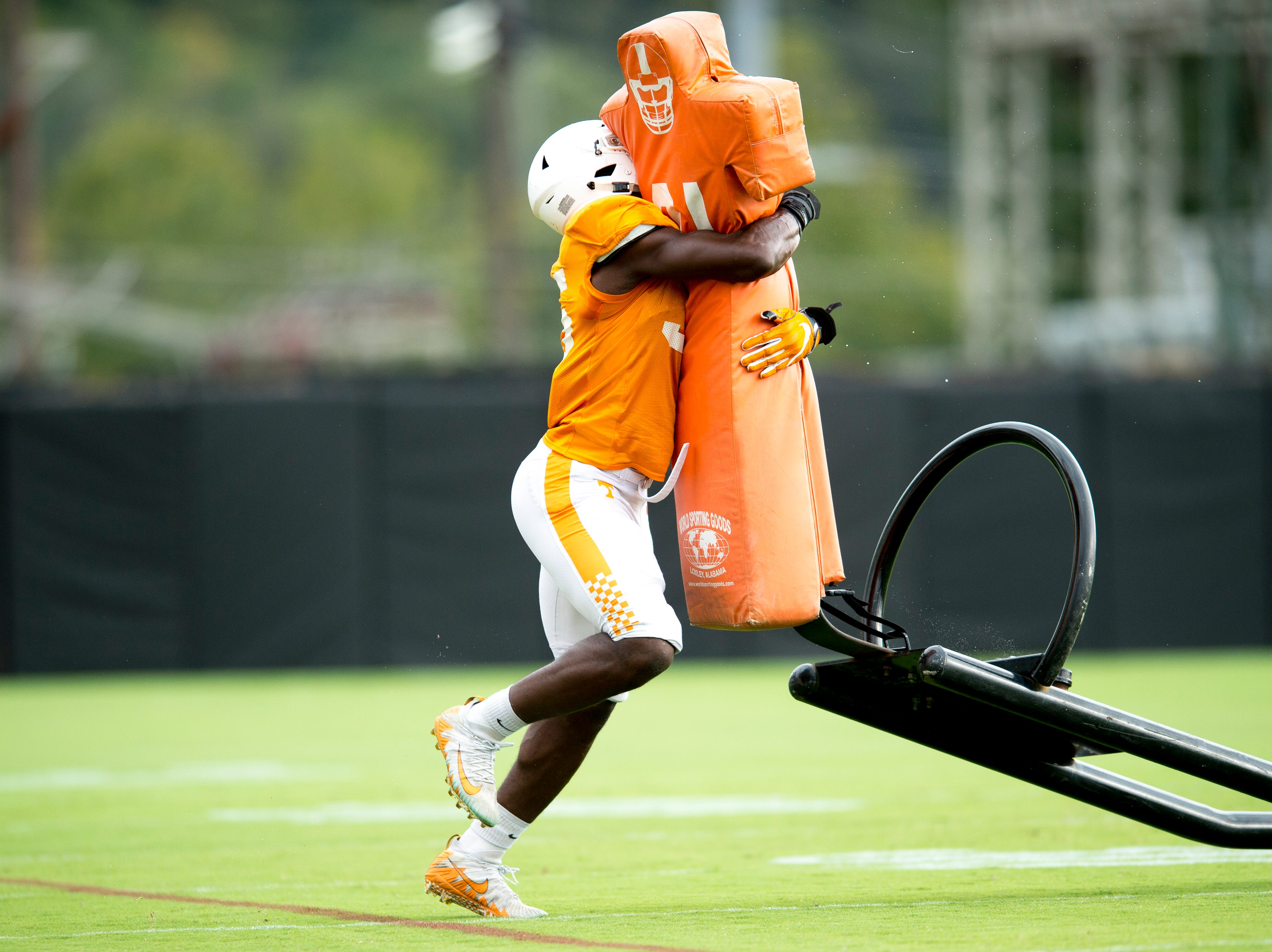 Tennessee linebacker Daniel Bituli (35) takes down a tackle sled during Tennessee fall football practice at Haslam Field in Knoxville, Tennessee on Tuesday, October 9, 2018.