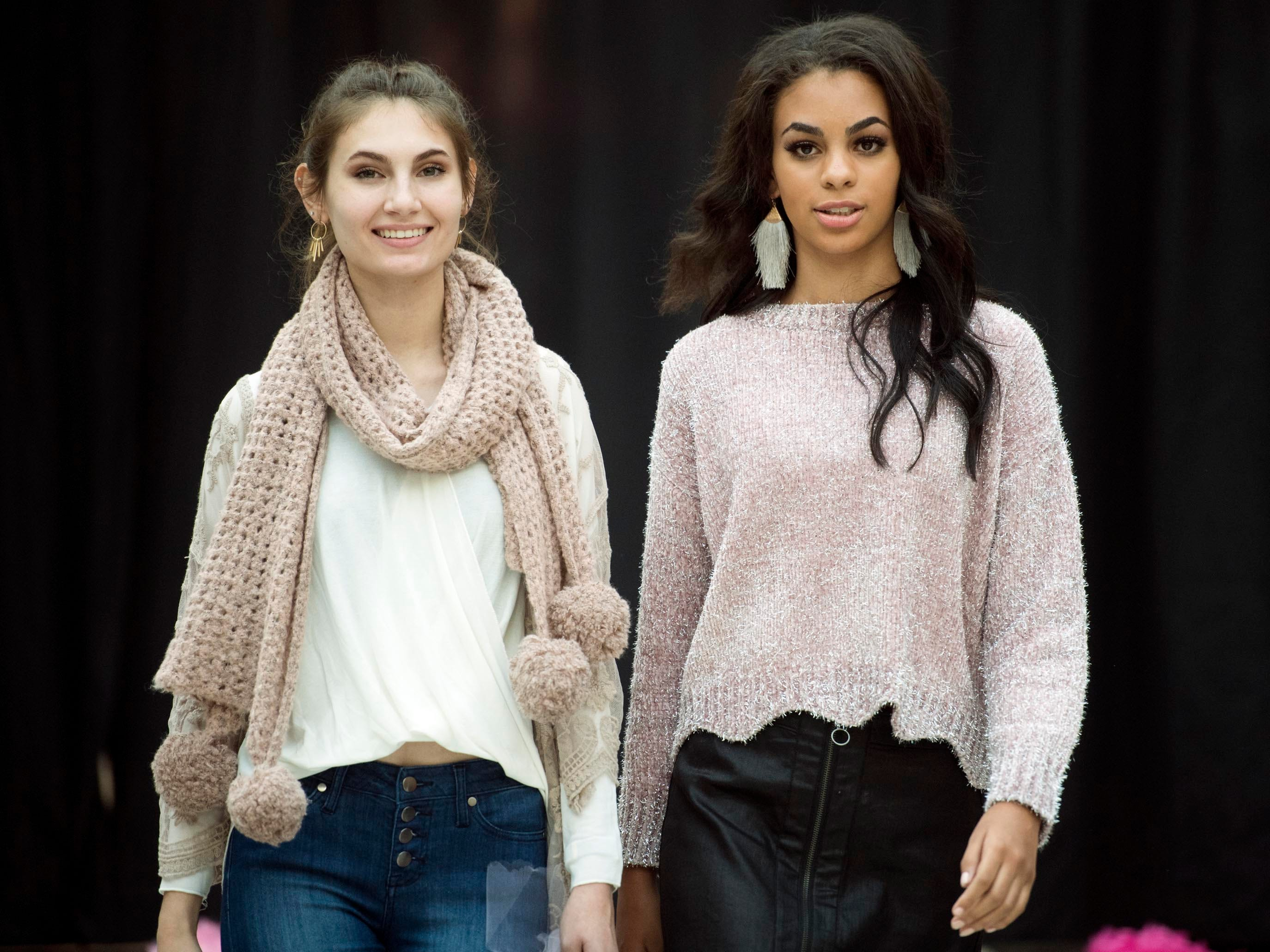 Athena and Emily, models courtesy of West Town Mall Fashion Board and Gate Model & Talent in clothing from Atar'd State during a fashion show coordinated by Claire Queisser Runway Events for West Town Mall's annual Survivor Fashion Show on Monday, October 8, 2018 to benefit Susan G. Komen.